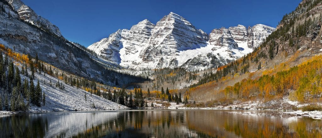 The snow covered Maroon Bells mountains in Colorado are stunningly beautiful.